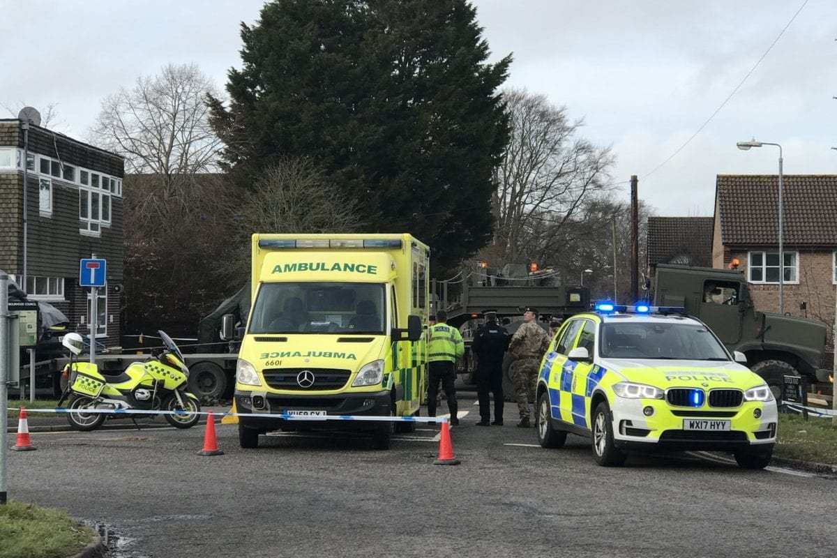 The ambulance, which carried the former Russian spy Sergei Skripal and his daughter Yulia to emergency after they found unconscious on a bench in Salisbury, is seen as it is dispatched to an unknown place with a military vehicle within the investigation in Salisbury, United Kingdom on March 10, 2018 [Tayfun Salcı / Anadolu Agency]
