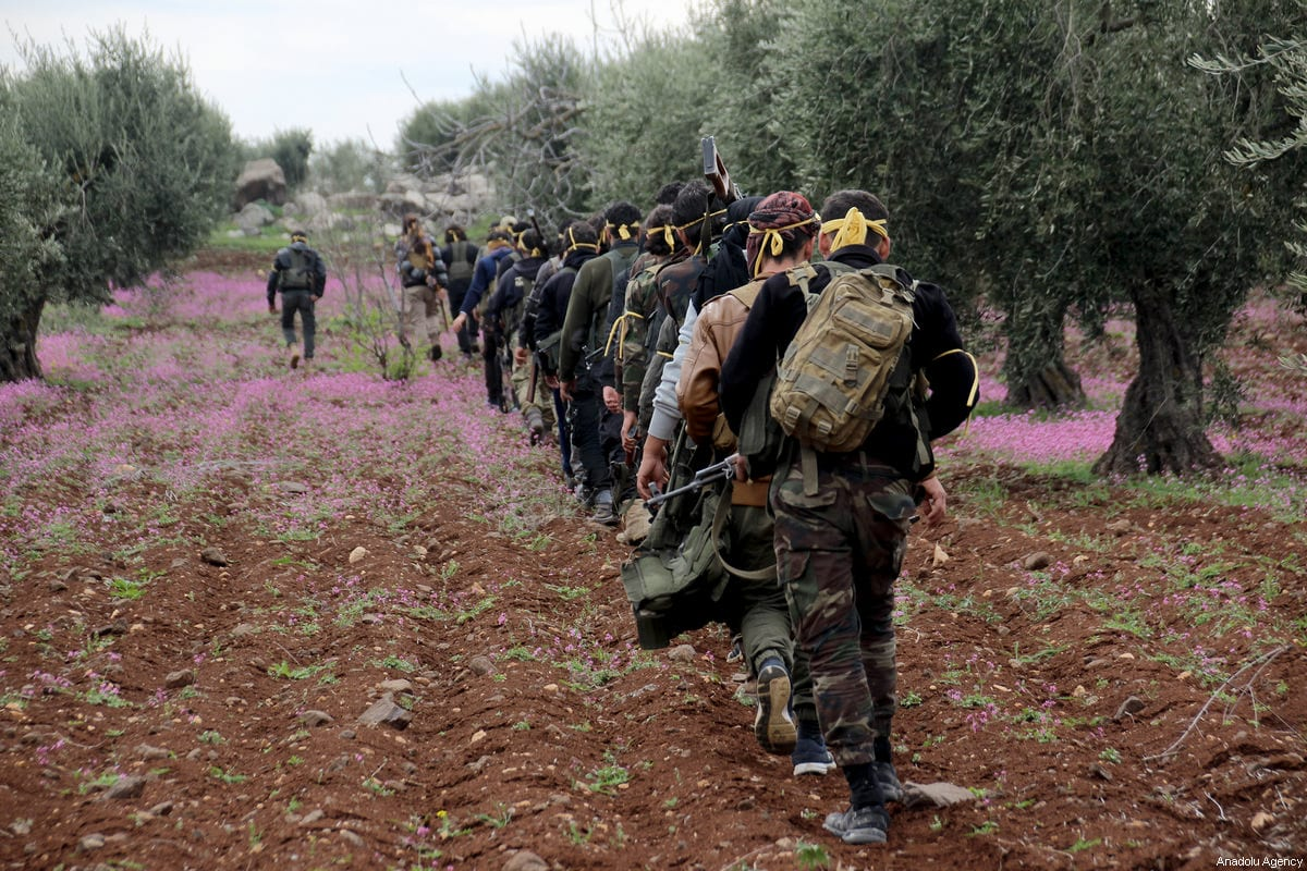 """Free Syrian Army members are seen after Turkish Armed Forces and FSA members cleared Khalidiah village in the northeastern Sharan district from PYD/PKK-Daesh terrorists within the """"Operation Olive Branch"""" in Afrin, Syria on March 11, 2018 [Beha el Halebi / Anadolu Agency]"""