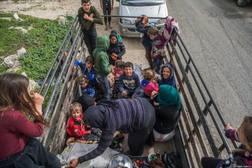 """A Syrian family is seen on a pick up truck with their belongings as they return to their homes Afrin and Idlib, after Turkish Armed Forces and Free Syrian Army (FSA) took complete control of northwestern Syria's Afrin from PKK/KCK/PYD-YPG and Daesh terror groups within the """"Operation Olive Branch"""" on 24 March, 2018 [Halil Fidan/Anadolu Agency]"""