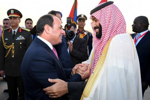 Crown Prince and Defense Minister of Saudi Arabia Mohammad bin Salman al-Saud (R) is welcomed by Egyptian President Abdel Fattah al-Sisi (L) at Cairo International Airport in Cairo, Egypt on 4 March, 2018 [Bandar Algaloud/Saudi Kingdom Council/Handout/Anadolu Agency])