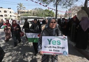Palestinian women protest ahead of International Womens Day [Mohammed Asad/Middle East Monitor]