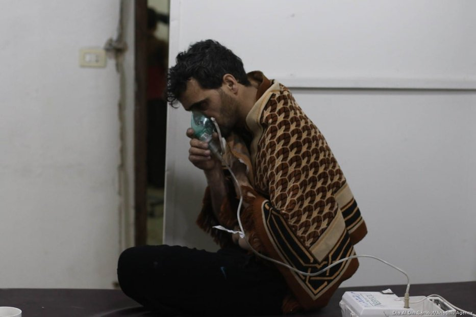 An affected man receives a medical treatment after Assad regime forces conduct allegedly poisonous gas attack on Sakba and Hammuriye districts of Eastern Ghouta, in Damascus, Syria on 7 March, 2018 [Dia Al Din Samout/Anadolu Agency]