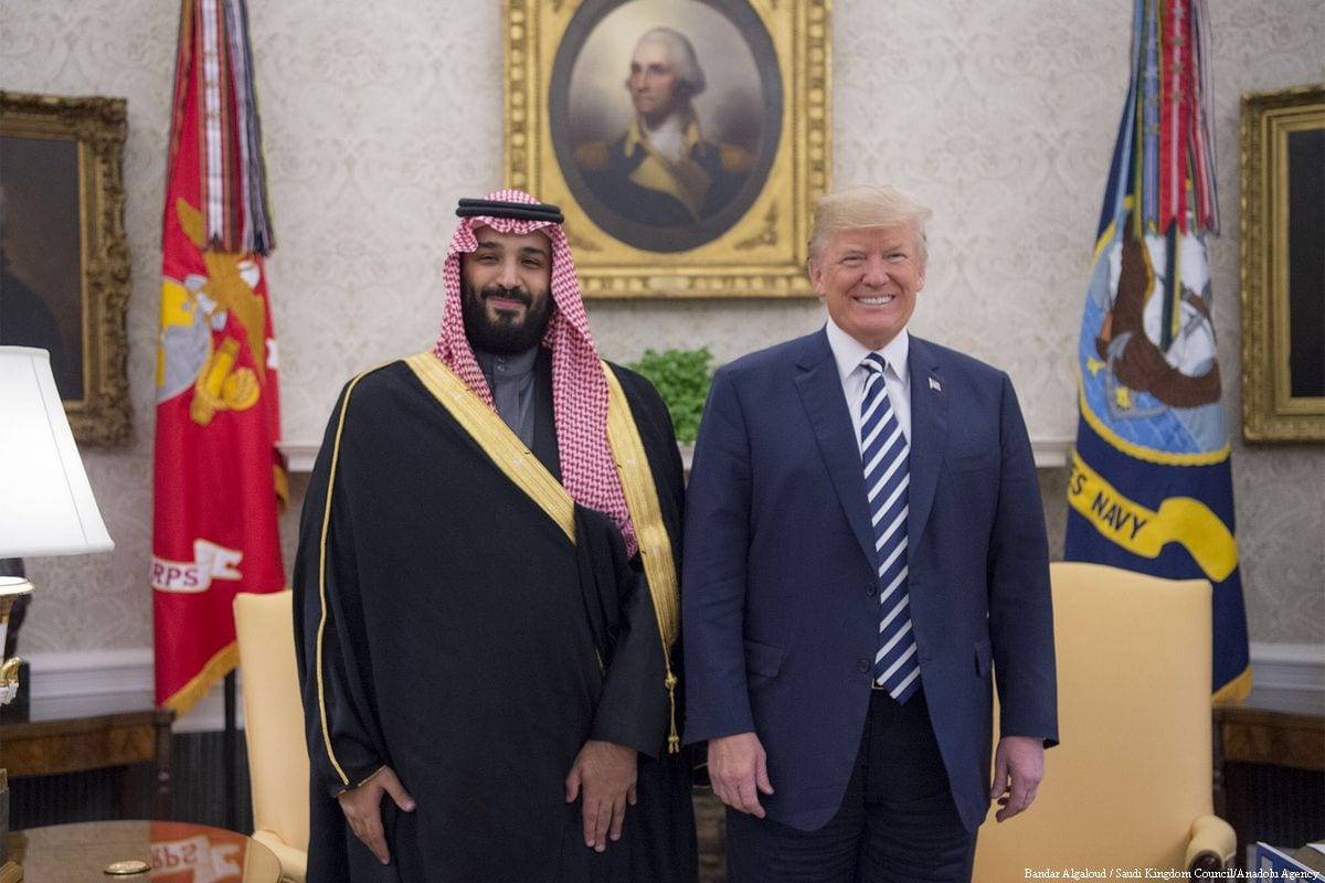 US President Donald Trump (R) poses for a photo with Crown Prince Mohammed bin Salman Al Saud (L) in Washington, US on 20 March 2018 [Bandar Algaloud/Saudi Kingdom Council/ Anadolu Agency]