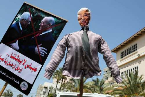 A Palestinian holds an effigy depicting Palestinian President Mahmoud Abbas during a protest against his statement in which he accuses Hamas of carrying out a bomb attack against prime minister Rami Hamdallah in Gaza on 21 March 2018 [Ashraf Amra/Apaimages]