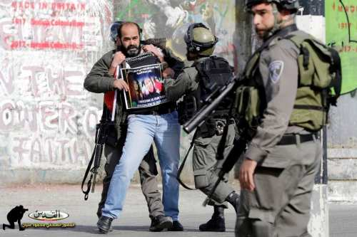 Munther Amira, head of the Popular Struggle Coordination Committee in the occupied West Bank, being detained by Israeli border police during a protest