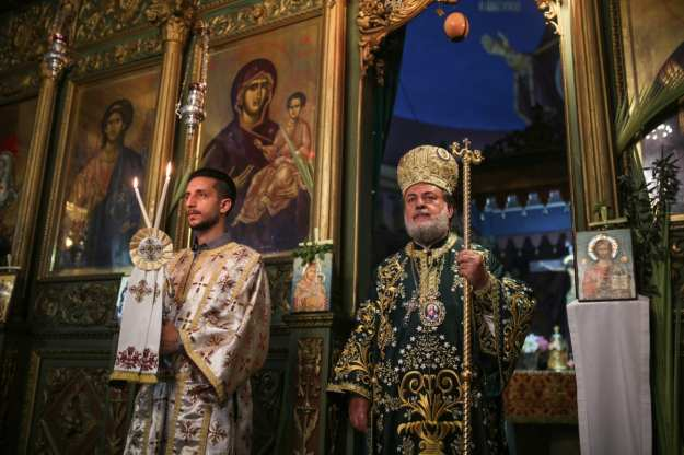 Archbishop Alexios (R) leads the Palm Sunday procession in Gaza City, Gaza on April 01, 2018 [Mustafa Hassona/Anadolu Agency]