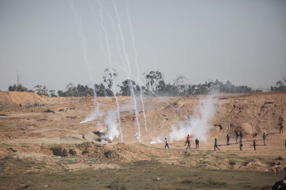 Israeli forces fire tear gas at Palestinian protesters during the Great March of Return in Gaza on 1st April 2018 [Hassan Jedi/Anadolu Agency]