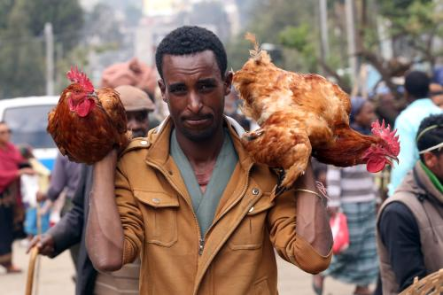 A man holds two chickens at the Sholla bazaar ahead of Easter celebrations in Addis Ababa, Ethiopia on 7 April, 2018 [Minasse Wondimu Hailu/Anadolu Agency]