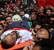 Thousands of Gazans attend funeral of Palestinian journalist Ahmed Abu Hussein