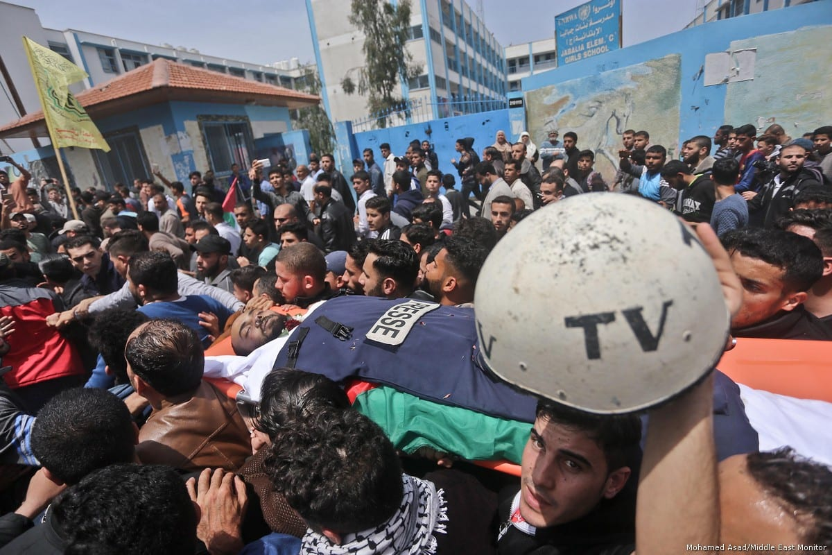 Thousands of Gazans attend funeral of Palestinian journalist Ahmed Abu Hussein [Mohamed Asad/Middle East Monitor]