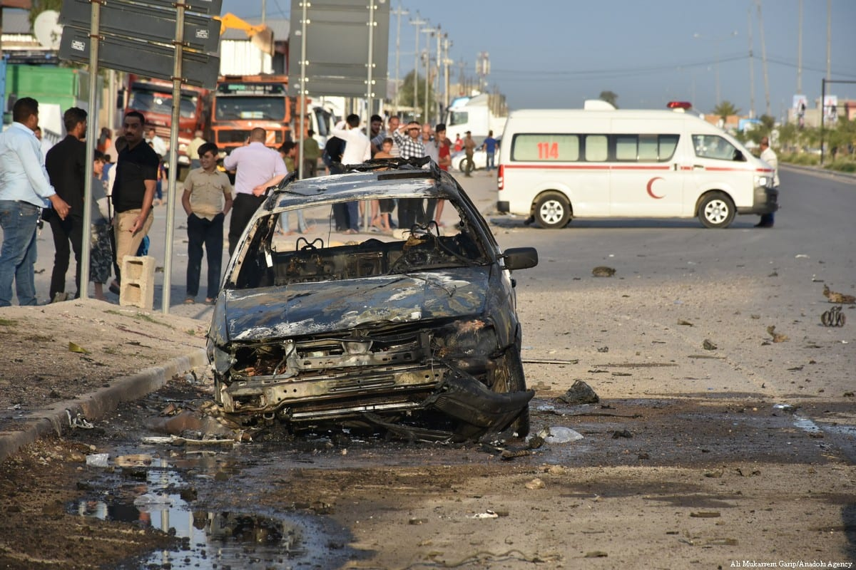 A destroyed vehicle is seen after an explosion was carried to assassinate a parliamentary candidate in Kirkuk, Iraq on 15 April 2018 [Ali Mukarrem Garip/Anadolu Agency]