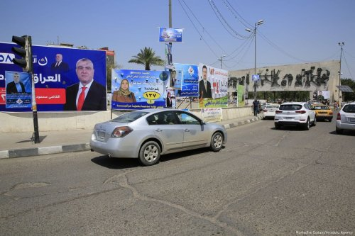 Posters of candidates are seen on billboards for the upcoming parliamentary election Baghdad, Iraq on 16 April 2018 [Murtadha Sudani/Anadolu Agency]
