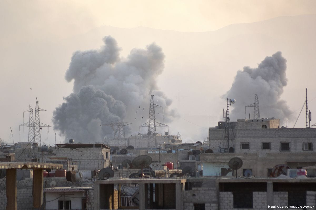 Smoke rises from air strikes carried out Assad regime in the Yarmouk refugee camp in Syria where Palestinian refugees take shelter on 24 April 2018 [Rami Alsayed/Anadolu Agency]