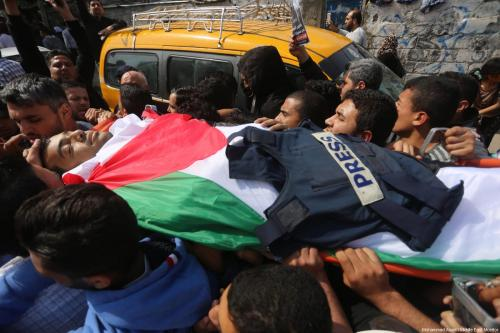 Funeral procession of Gazan video journalist and photographer Yaser Murtaja, killed by Israeli snipers despite wearing a vest marked 'PRESS', while covering the The Great March of Return on April 6, 2018 [Mohammad Asad / Middle East Monitor]