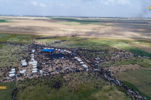 Palestinians come together near Gaza's eastern border for 'The Great March of Return' [Yaser Murtaja / Ain Media]