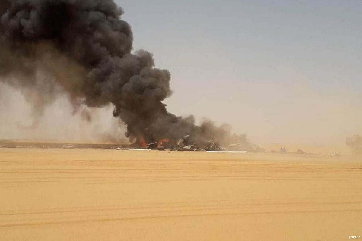 Smoke rises from a plane crash near Libya's Sharara oilfield on 30 April 2018 [Twitter]