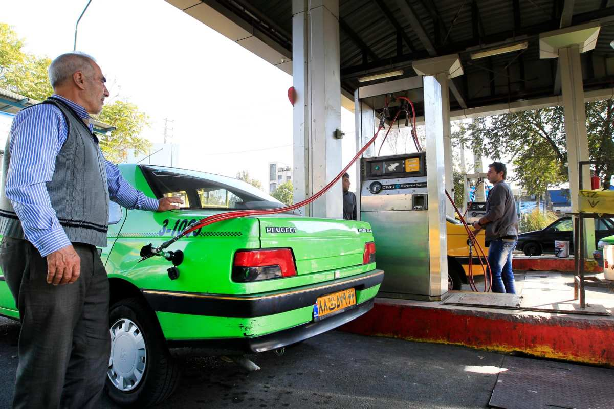An Iranian tax driver seen filling up at a CNG/Petrol Station [file]