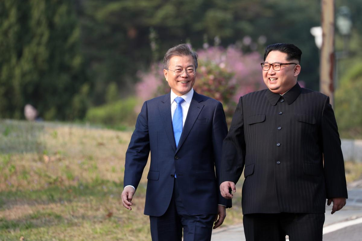 South Korean president, Moon Jae-in (L) and North Korean leader Kim Jong-un (R) take a walk after planting a commemorative tree in the Peace House building at the southern side of the truce village of Panmunjom, South Korea on 27 April, 2018 [Anadolu Agency]