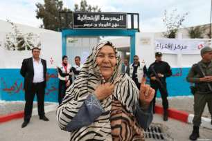 A woman poses for a photo after casting her vote at a polling station during Tunisian local elections, which was held first time after 2011 Arab Spring revolution, in Ben Arous, Tunisia on May 06, 2018. ( Yassine Gaidi - Anadolu Agency )