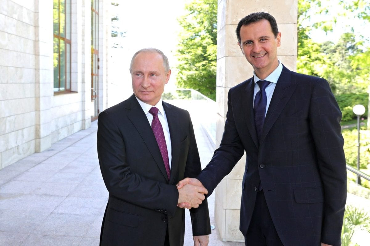 Russian President Vladimir Putin (R) meets President of Syria Bashar Al-Assad (L) in Sochi, Russia on 17 May, 2018 [Kremlin Press Office/Anadolu Agency]