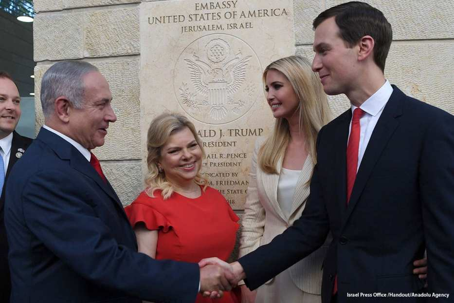 Trump's son-in-law and Senior Advisor Jared Kushner (R) and Israel's Prime Minister Benjamin Netanyahu (L) shake hands at the opening of the US embassy in Jerusalem on 14 May 2018 [Israel Press Office /Handout/Anadolu Agency]