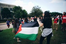 Pro-Palestinian activists walk out of a talk by UN envoy to the UN, Nikki Haley, at the University of Houston on 22 May 2018. The students disrupted her speech saying she 'signed off on genocide' [mariam z/Twitter]