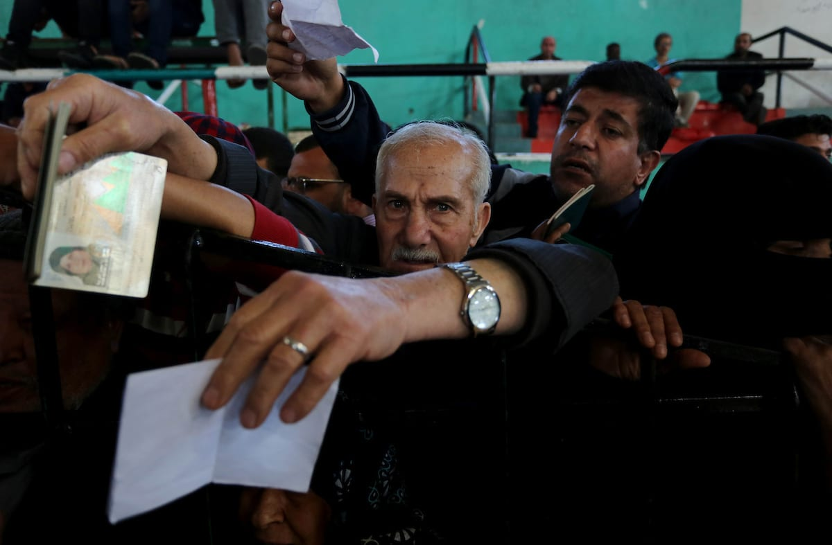 Palestinians wait for travel permits to cross into Egypt through the Rafah border crossing after it was opened by Egyptian authorities for humanitarian cases, in Khan Yunis in the southern Gaza Strip on 29 April, 2018 [Ashraf Amra/Apaimages]