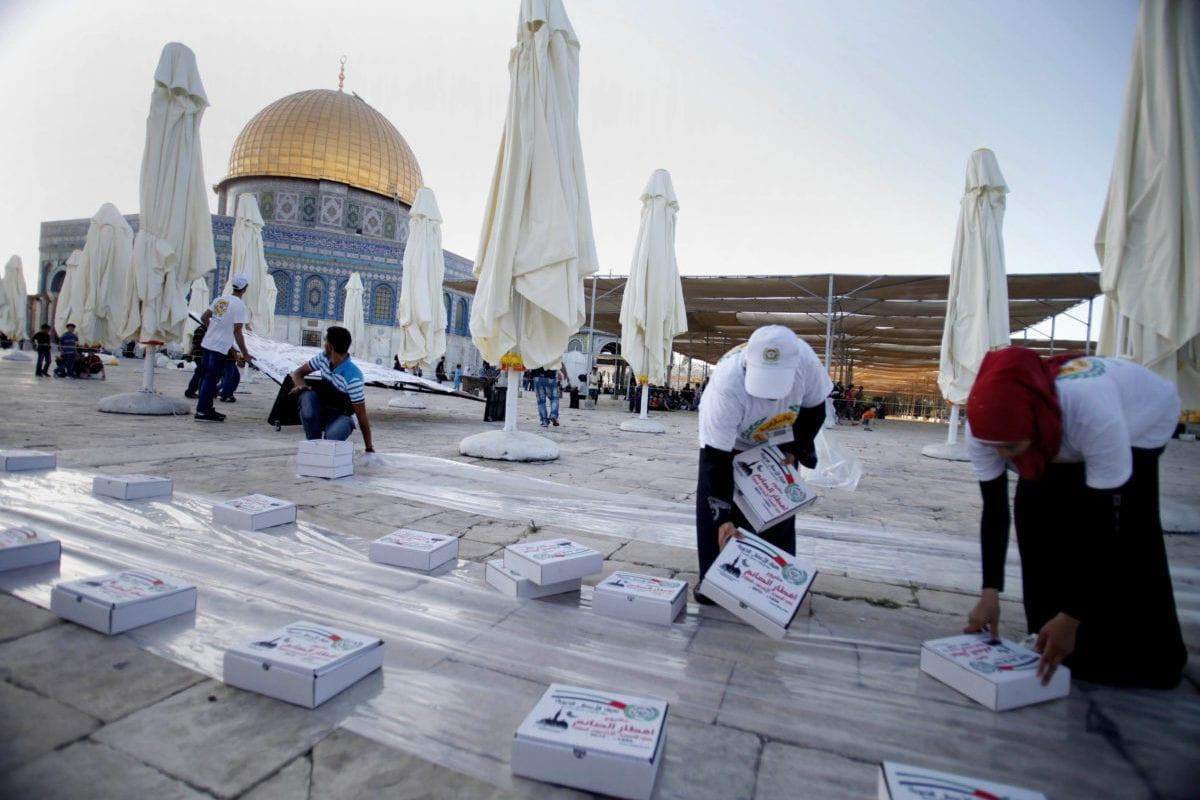 Volunteers prepare for the Iftar meal, provided as donations, at al-Aqsa mosque compound in the old city of Jerusalem, on July 17, 2013 [Saeed Qaq / ApaImages]