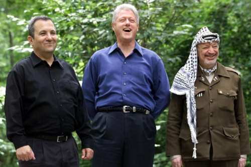 U.S. President Bill Clinton, Israeli prime minister Ehud Barak and Palestinian leader Yasser Arafat at Camp David, July 2000 [Wikipedia]