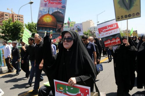 Iranians march towards Tehran University during International Al-Quds Day protest in Tehran, Iran on 8 June, 2018 [Fatemeh Bahrami/Anadolu Agency]