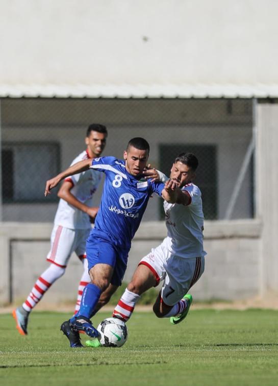 Khaled Al - Quqa of Shabab Khan Yunis in action during Palestine Cup final match between Shabab Khan Yunis and Hilal Al-Quds at Palestine Stadium in Gaza City, Gaza on 20 June, 2018 [Mustafa Hassona/Anadolu Agency]