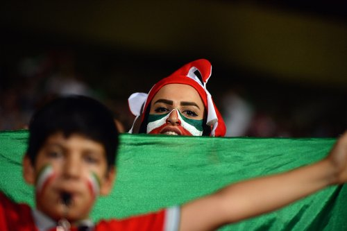 Fans gather for a public viewing event at Azadi Stadium in Tehran, Iran on 25 June, 2018, to watch the 2018 FIFA World Cup Russia Group B match between Iran and Portugal [Fatemeh Bahrami/Anadolu Agency]