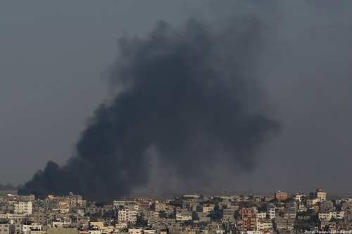 Smoke rises after the Israeli Air Force carried out an air strike over Gaza City, Gaza on May 29, 2018 [Ashraf Amra / Anadolu Agency]