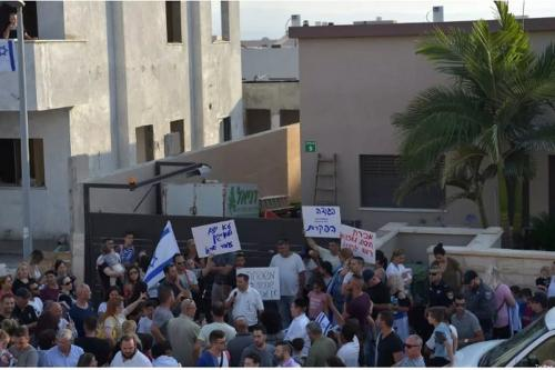 Residents of northern Israeli town Afula demonstrate against the sale of a house to a family of Palestinian citizens on 13 June 2018 [Twitter]