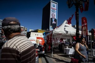 People gather around the election booths and tents opened by Turkish parties within Turkey's presidential and general elections campaign at Kizilay square in Ankara, Turkey on 13 June 2018 [Özge Elif Kızıl/Anadolu Agency]