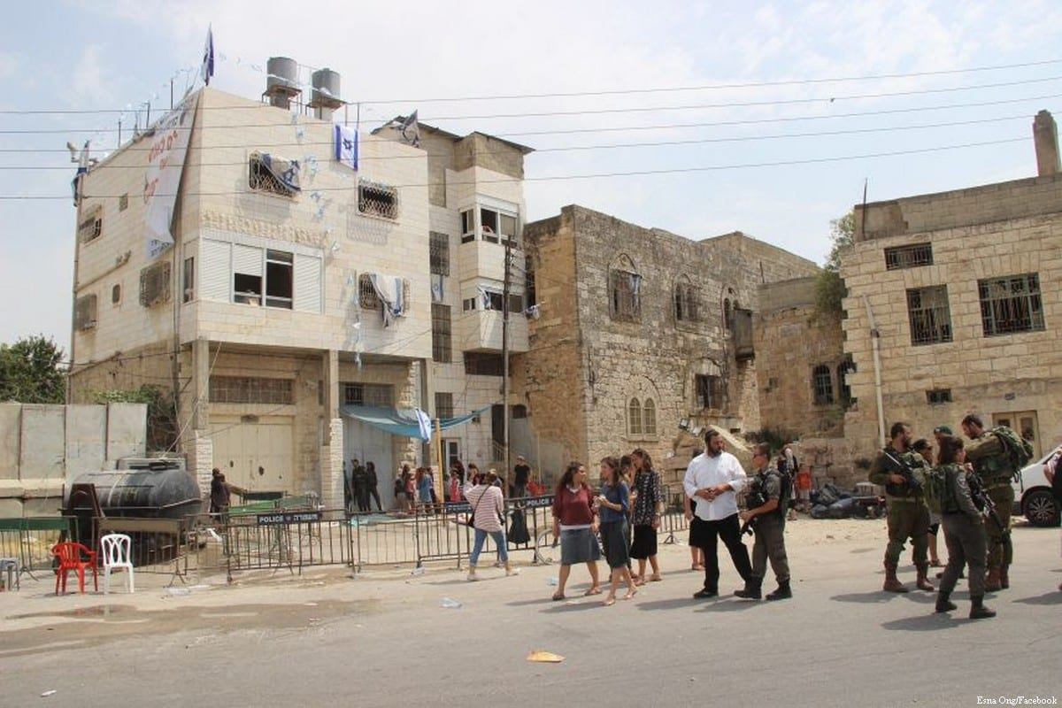 Illegal Israeli settlers take over an Arab house in the occupied Old City of Hebron, West Bank, on 4 June 2018