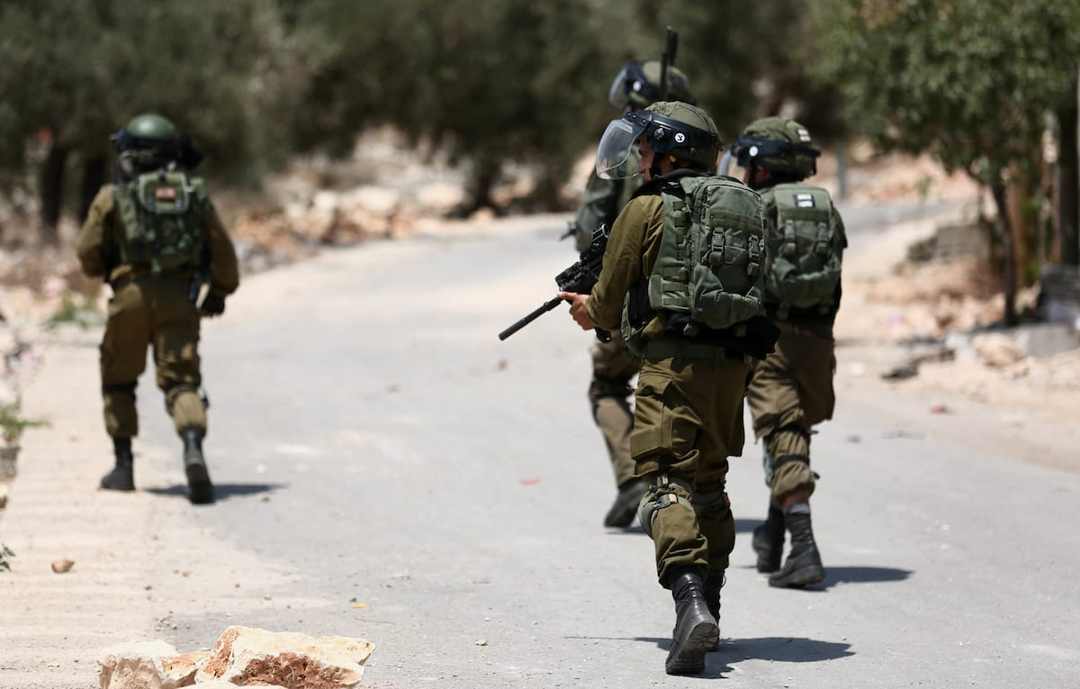 Israeli troops take position during clashes with Palestinian protesters following a demonstration against the expropriation of Palestinian land by Israel in the village of Kfar Qaddum, near Nablus, in the occupied West Bank on 22 June, 2018 [Shadi Jarar'ah/Apaimages]