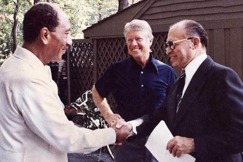 Israeli prime minister Menachem Begin and Egyptian president Anwar Sadat with US president Jimmy Carter at Camp David in September 1978 [US Gov]
