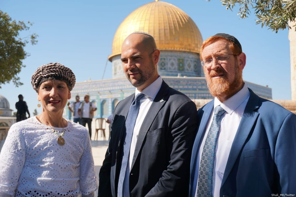 Knesset members Yehuda Glick (R) and Amir Ohana (C) and Shuli Mualem can be seen outside Al-Aqsa Mosque