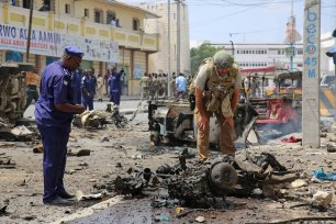 Somalian security forces inspect after a bomb laden car attack by al-Shabab militants in front of Interior Ministry in Mogadishu, Somalia on July 07, 2018 [Sadak Mohamed / Anadolu Agency]
