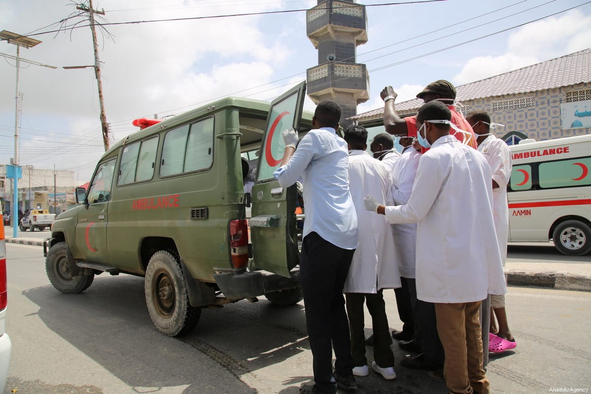 Health staff place an injured person in an ambulance after a bomb laden car attack by al-Shabab militants in front of Interior Ministry in Mogadishu, Somalia on July 07, 2018 [Sadak Mohamed/Anadolu Agency]
