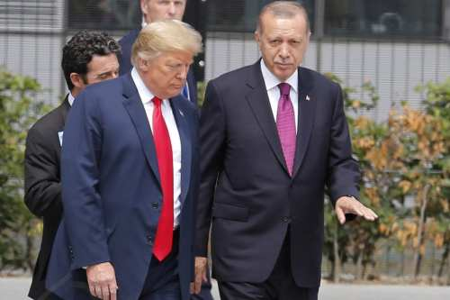 Turkish President Recep Tayyip Erdogan (R) talks to U.S. President Donald Trump (L) attends the 2018 NATO Summit at NATO headquarters on 11 July, 2018 in Brussels, Belgium [Murat Kaynak/Anadolu Agency]