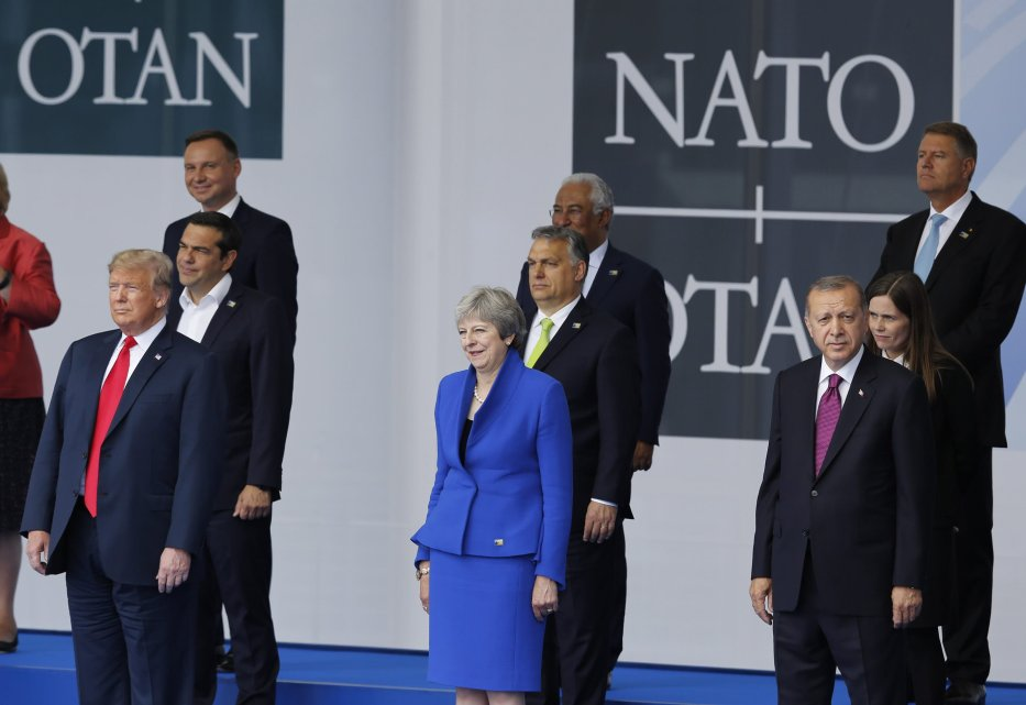 U.S. President Donald Trump (L), British Prime Minister Theresa May (C) and Turkish President Recep Tayip Erdogan (R) attend the 2018 NATO Summit at NATO headquarters on 11 July, 2018 in Brussels, Belgium. [Murat Kaynak/Anadolu Agency]