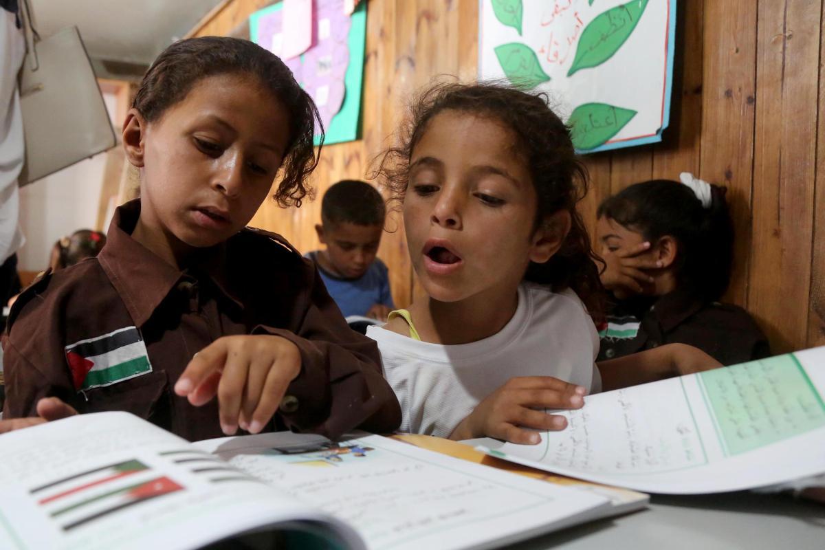 Palestinian bedouin children receive education in classroom at the only school in the region 'Itarat School' in Khan al-Ahmar region of Jerusalem on 16 July, 2018 [Ä°ssam Rimawi/Anadolu Agency]