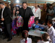 Palestinian Education Minister Sabri Saidam gives school bags to Bedouin children in a classroom at the only school in the region 'Itarat School' in Khan al-Ahmar region of Jerusalem on 16 July, 2018 [İssam Rimawi/Anadolu Agency]