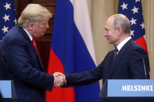 U.S. President Donald Trump (L) and Russia's President Vladimir Putin (R) hold a joint press conference after their bilateral meeting in Helsinki, Finland on 16 July, 2018 [Stringer/Anadolu Agency]