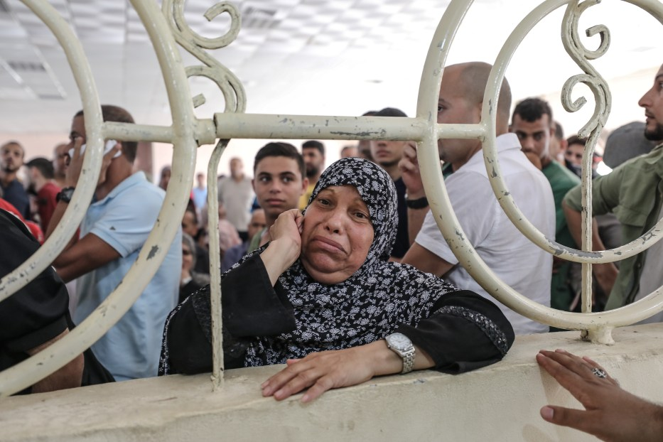 Palestinians wait for passport control to cross to Egypt following the re-opening of Rafah crossing point in Rafah, Gaza on 17 July, 2018 [Ali Jadallah/Anadolu Agency]