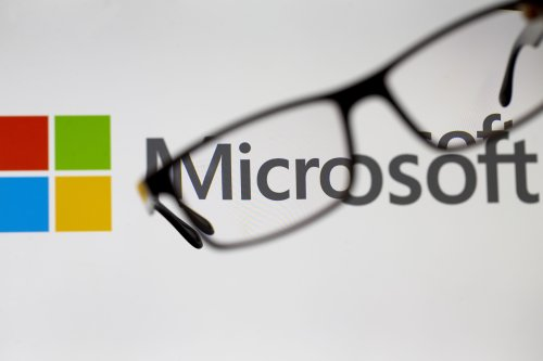 Glasses are seen in front of a computer screen showing a Microsoft logo in Ankara, Turkey on 19 July, 2018 [Aytaç Ünal/Anadolu Agency]