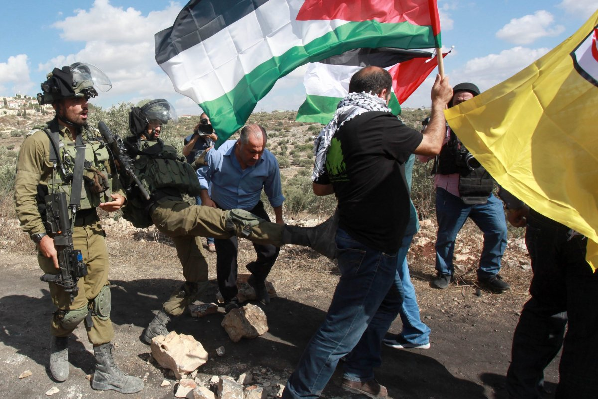 Israeli forces intervene in a protest against construction of Israeli settlement and separation wall at Kafr Qaddum village in Nablus, West Bank on 28 July, 2018 [Nedal Eshtayah/Anadolu Agency]