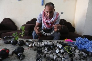 bu Attaya collects these bombs and turn them into a message of peace for the world to see [Mohammed Asad/Middle East Monitor]